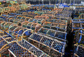 Lobster pots on a quayside — Stock Photo