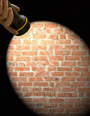 Spotlight frame on a brick wall — 图库照片