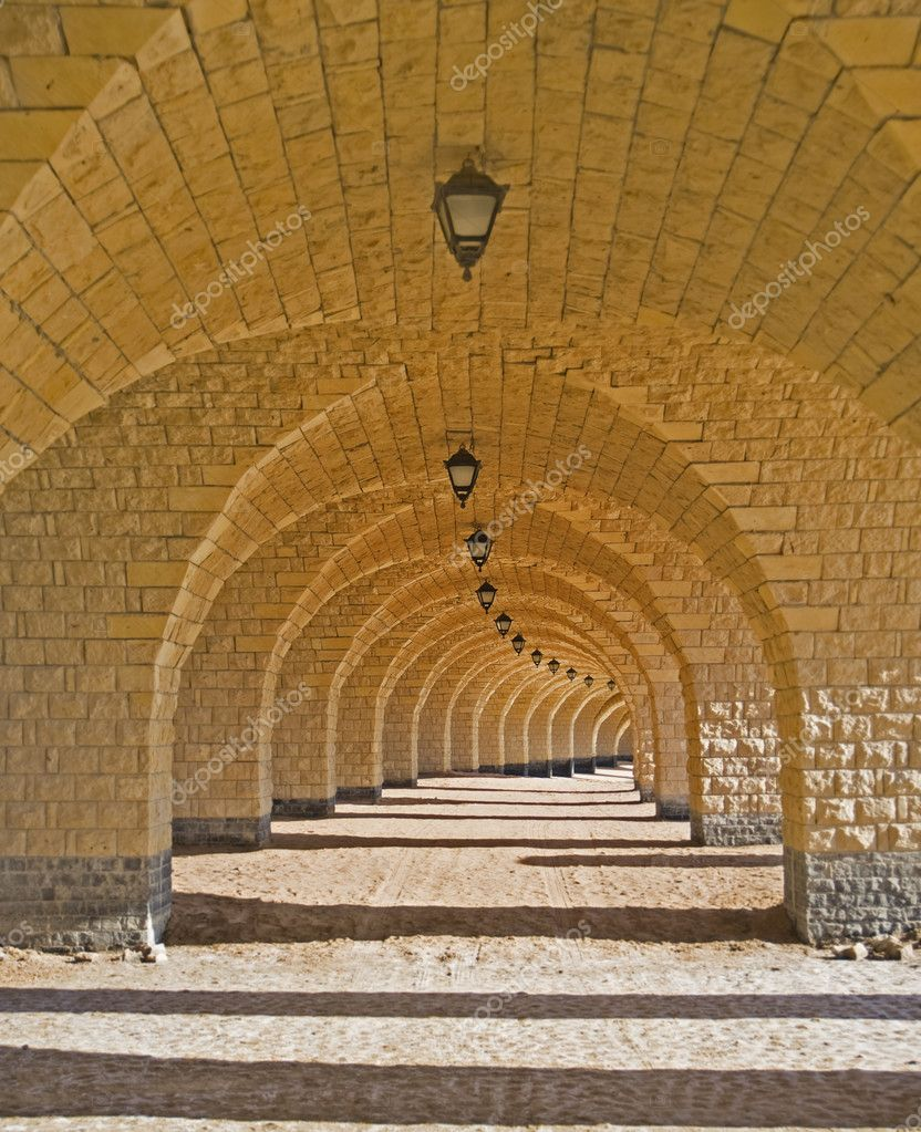A corridor of archways on a beach — Stock Photo #3197884