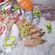 Fresh seafood display on ice - ストック写真