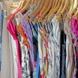 Clothing hanging on rail — Stockfoto #3364763