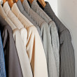 Clothing hanging on a rail — Stock Photo