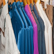 Clothing hanging on a rail — Stock Photo #3364810