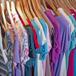 Stock Photo: Clothing hanging on rail