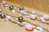 Bead necklace on a wooden surface — Stock Photo