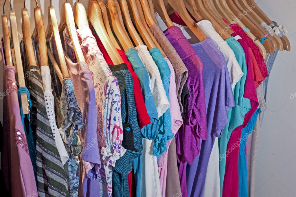 Various items of clothing hanging from a rail in a shop display — Stock Photo #3364869