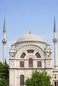 Ornate mosque with blue sky — Stock Photo