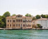 Luxury villa on a river — Stock Photo