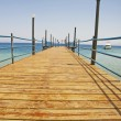 Wooden jetty on a tropical beach — 图库照片
