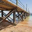 Wooden jetty on a tropical beach — Stock Photo #3449372