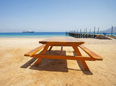 View from a tropical beach with picnic table — Stock Photo