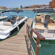 Private motor yachts moored to a jetty — Stock Photo