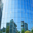 Large curved glass building — Stock Photo