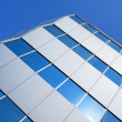 Corner of a glass office building — Stock Photo