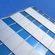 Stock Photo: Corner of a glass office building