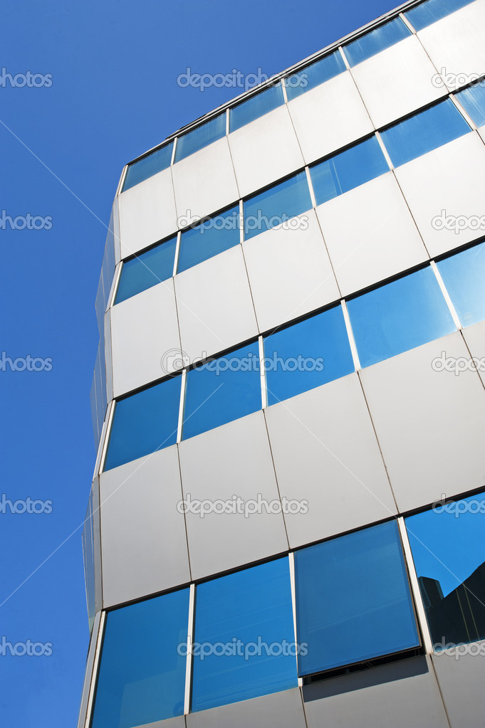 Abstract corner of an office building with reflective glass — Stock Photo #3689780