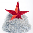 Christmas star and silver tinsel on white — Stock Photo