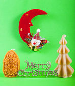 Merry christmas sign with xmas candles — Stock Photo