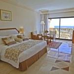 Luxury hotel bedroom with sea view — Stock Photo
