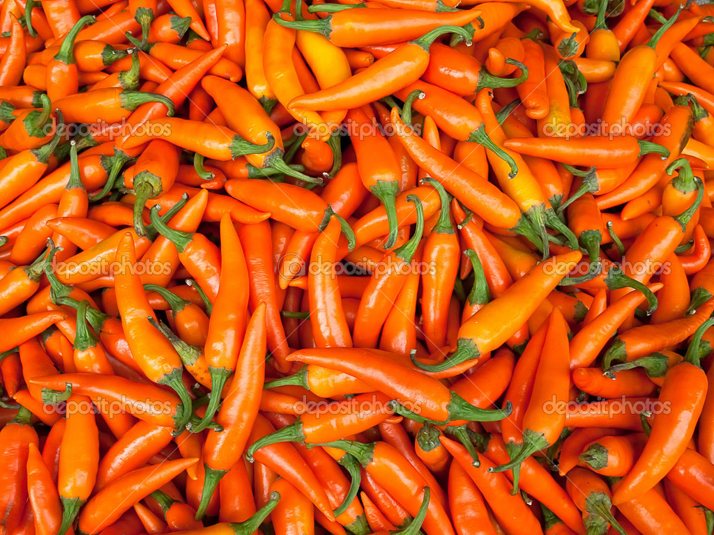 Many beautiful orange pepper sold in the market. — Stock Photo #3190297