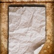 Crumpled paper on old wall — Stockfoto