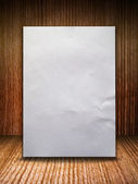 Crumpled paper on wood wall — Stock Photo