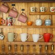 图库照片: Coffee cup on wood shelf