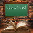 Back to school blackboard on brick wall — Stock Photo