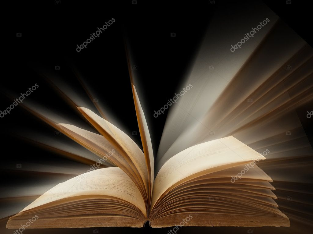 Old book open bright light on black background  Stock Photo #3900509