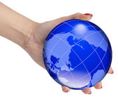 Hand holding the world globe — Stock Photo