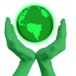 Green hands holding the world globe — Stock Photo
