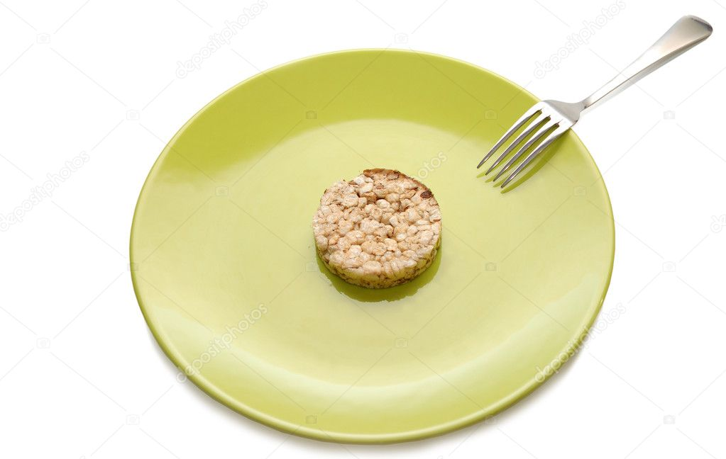 Green plate with cereal dietary pastry and fork — Stock Photo #3921002