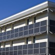 Stock Photo: Building equipped with solar panels