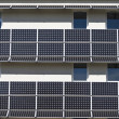 Building equipped with solar panels - Stock Photo