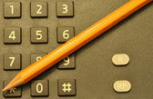 Telephone and pencil for notes — Stock Photo