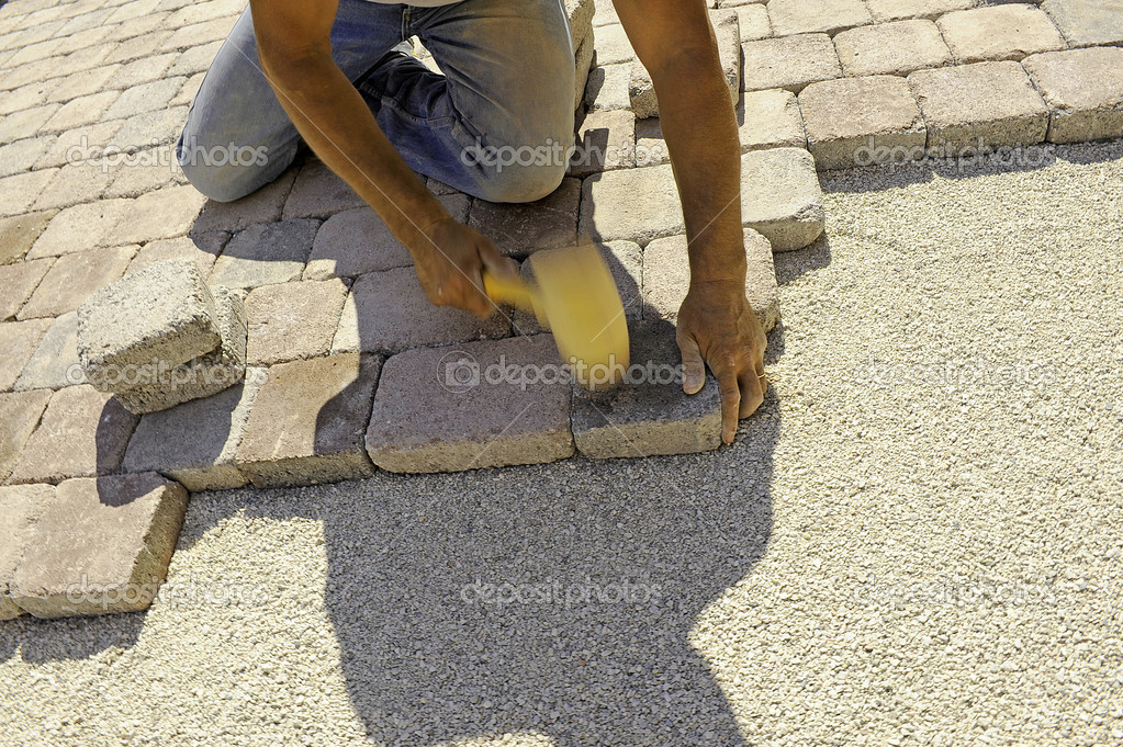 Man at work paving stones with rectangular  Stock Photo #3641467