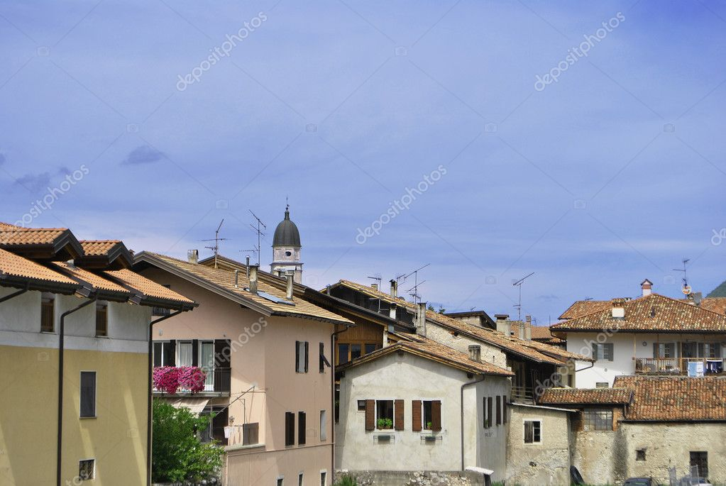 Small town with a bell tower and residential buildings with blue sky  Stock Photo #3714136