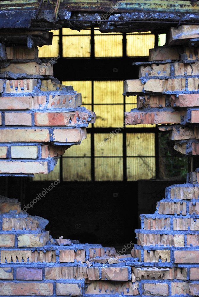 Hole in the wall of red brick with concrete background blue plastic pellets — Stock Photo #3767416