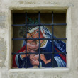 A saint painting in kirk window. - Stock Photo
