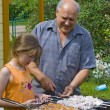 Royalty-Free Stock Photo: Grandfather, granddaughter and kebab