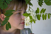 Girl smelling flowers — Stock Photo