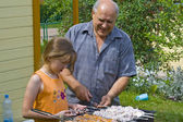 Grandfather, granddaughter and kebab — Stock Photo