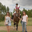 Stock Photo: Three girls and a horse