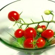 Cluster of cherry tomatoes in a small plate — Stock Photo