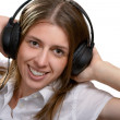 Stock Photo: Girl listens to music