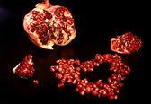 The tasty pomegranate looks as heart — Stock Photo