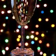 Stock Photo: Champagne with garland on background
