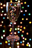 Champagne with garland on the background — Stock Photo