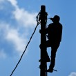 Man working on the pole — Stock Photo #3233151