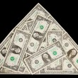 Dollars in shape of pyramid — Stock Photo